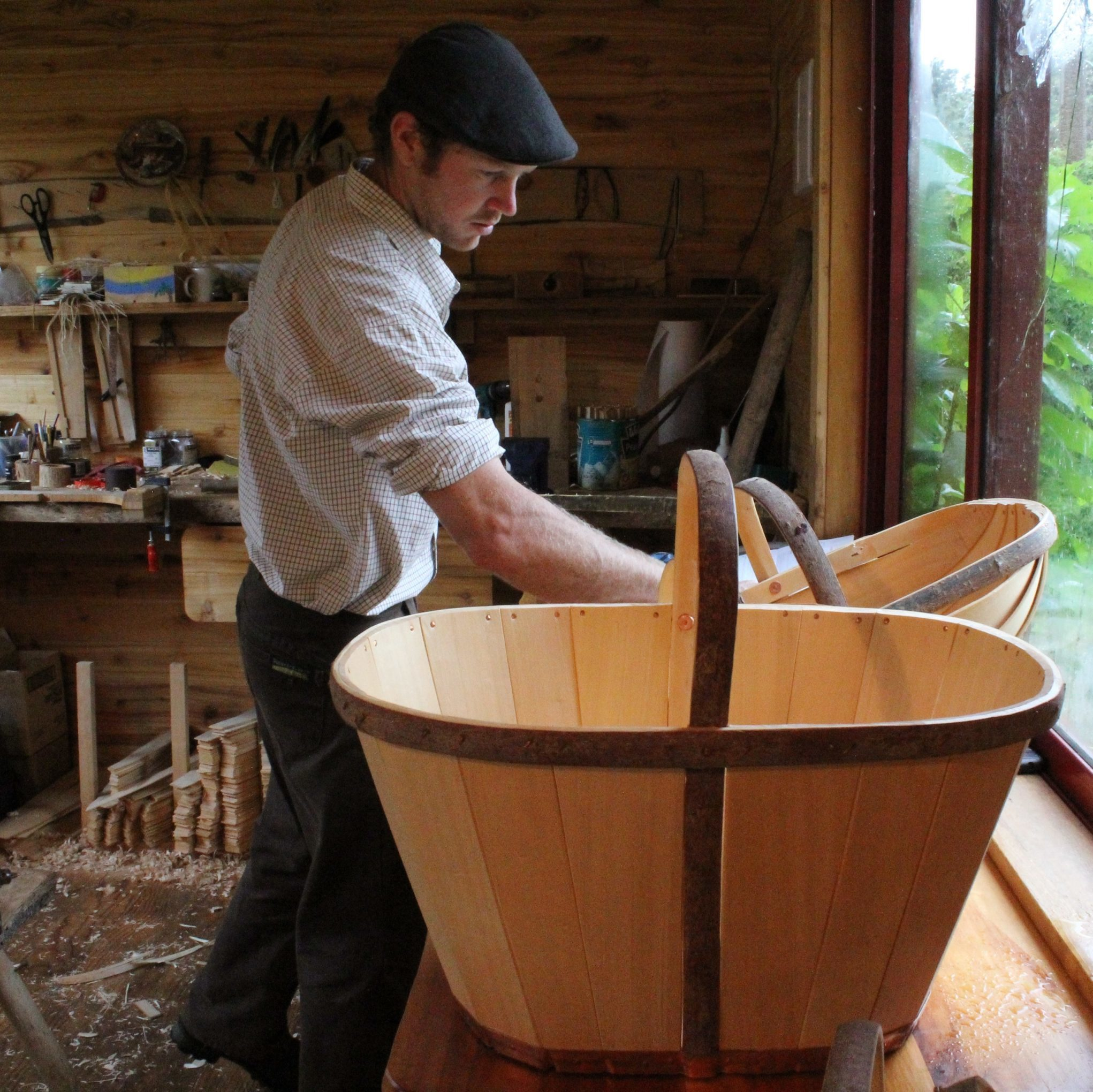 Tony in his workshop with a trug in the foreground